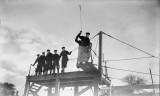 1940-1945 - HO RATINGS RECEIVING INSTRUCTION IN HEAVING THE LEAD.jpg