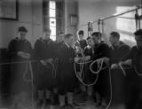 1940-1945 - HO RATINGS RECEIVING ROPE WORK TRAINING.jpg
