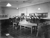 1940-1945 - HO RATINGS UNDERGOING TRAINING AROUND A MODEL BATTLESHIP.jpg