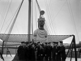 1940-1945 - GROUP OF NEW ZEALAND RATINGS STANDING BELOW THE MAST.jpg