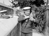1914-18 - NANCY, THE MASCOT OF R.N.T.E. SHOTLEY WITH A SAILOR AND A CHIEF YEOMAN INSTR. LOOKING ON.jpg