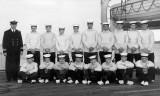 1963 - LT. CDR. BEZANCE, DUNCAN DO, WITH COXSWAINS ON THE PIER.jpg