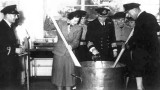 1952, FEBRUARY - BUNGY WILLIAMS, CAPT. AND MRS. WHITFIELD, STIR XMAS PUD IN NEW CMG.jpg