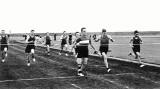 1955 - ALAN JOHNS, SPORTS DAY, ALAN, WITH WHITE STRIPE WINNING THE 100 YARDS RACE.jpg