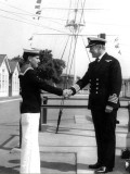1970 - ADRIAN KING, PARENTS DAY BUTTON BOY, RECEIVING HIS CROWN PIECE FROM CAPT. BUTTON.jpg
