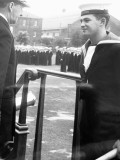1961, 6TH FEBRUARY - ALEC TARASIUK, J.N.A.M.2., RECEIVING SOFTBALL PRIZE FROM CAPT. GOWER IN THE SUMMER.jpg