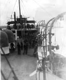 UNDATED - DICKIE DOYLE, HMS CAROLINE AT HARWICH, COALING SHIP.jpg