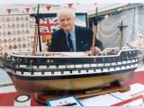 1949 - CLIFF BOYDEN, JOINED GANGES IN THIS YEAR AND IS SEEN WITH A MODEL OF HMS GANGES THAT HE MADE FOR THE MUSEUM, 01.