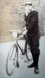 UNDATED - UNKNOWN PETTY OFFICER IN SQUARE RIG WITH BIKE..jpg