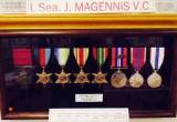 UNDATDED - DAVID RYE, EX GANGES BOY, LEADING SEAMAN, J.J. MAGENNIS'S REPLICA MEDALS IN THE GANGES MUSEUM.jpg