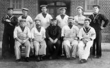 1914c - GROUP OF POSSIBLE INSTRUCTORS, NOTE ONE ON LEFT HOLDING A KITTEN..jpg