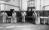 1914c - 4 POSSIBLE INSTRUCTORS IN THE LAUNDRY SHOTLEY BARRACKS.jpg