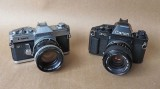Canon Pellix (1965, with a FL lens) and Canon F1n (1981).