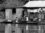 People, outside Manaus, live on house-boats.