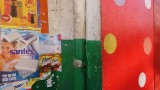 Colorful wall advertising in Tana