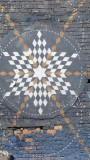 This design was painted on a wall near a viewpoint overlooking the Capital City