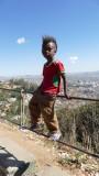 Kid at viewpoint overlooking Tana