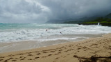 Brave swimmers at Pounders Beach
