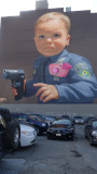 Baby with a Handgun