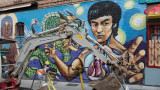 Bruce Lee vs. Backhoe