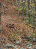 The picnic table by the stream on a Fall day