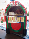 The tiny juke box in the coffee shop
