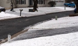 Ice covered driveways down the street