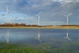 Wind turbines near flooded meadows