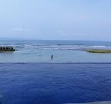 Pool and sea. Bali Santi Bungalows. Candi Dasa
