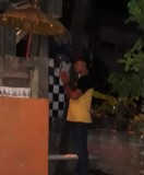 One of the staff at some restaurant. Candi Dasa