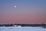 Snow Moon setting in rural Wisconsin