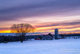 Sunset colors and farm