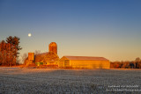 Setting full moon and barn