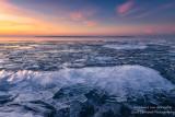Ice shards at sunset, Sand Island at horizon