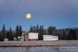 Full moon setting behind a farmstead 2