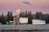 Full moon setting behind a farmstead 3
