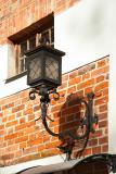 Lantern On A Brick Wall