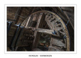 The toothed brakewheel just behind the windshaft head.