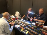 Butch Eyler and Norm Wolf talk weathering freight cars.