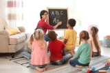 Teacher-and-Class-ABCs-on-Chalkboard.jpg