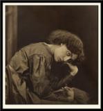 Jane Morris seated on a divan, 1865