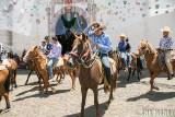 Men on horseback in procession