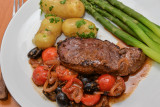 Lamb Steaks with Olives and Tomatoes