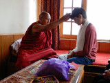 Getting blessed by a rimpoche, just as he had 13 years earlier