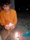 Lighting a dia for Diwali