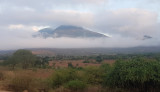 Arusha is on a high plateau with peaks rising from it.