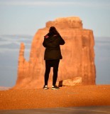 Tourist and Mitten Butte at sunset, Monument Valley, Navajo Tribal Park, Navajo Nation, Arizona 666
