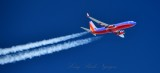 Southwest Airlines passing 1000 feet overhead at 37000 feet 036