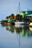 Sailboat and powered boat and lime green color, Islamorada, Florida Keys, Florida 014