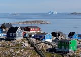 Hilltop houses with icebergs